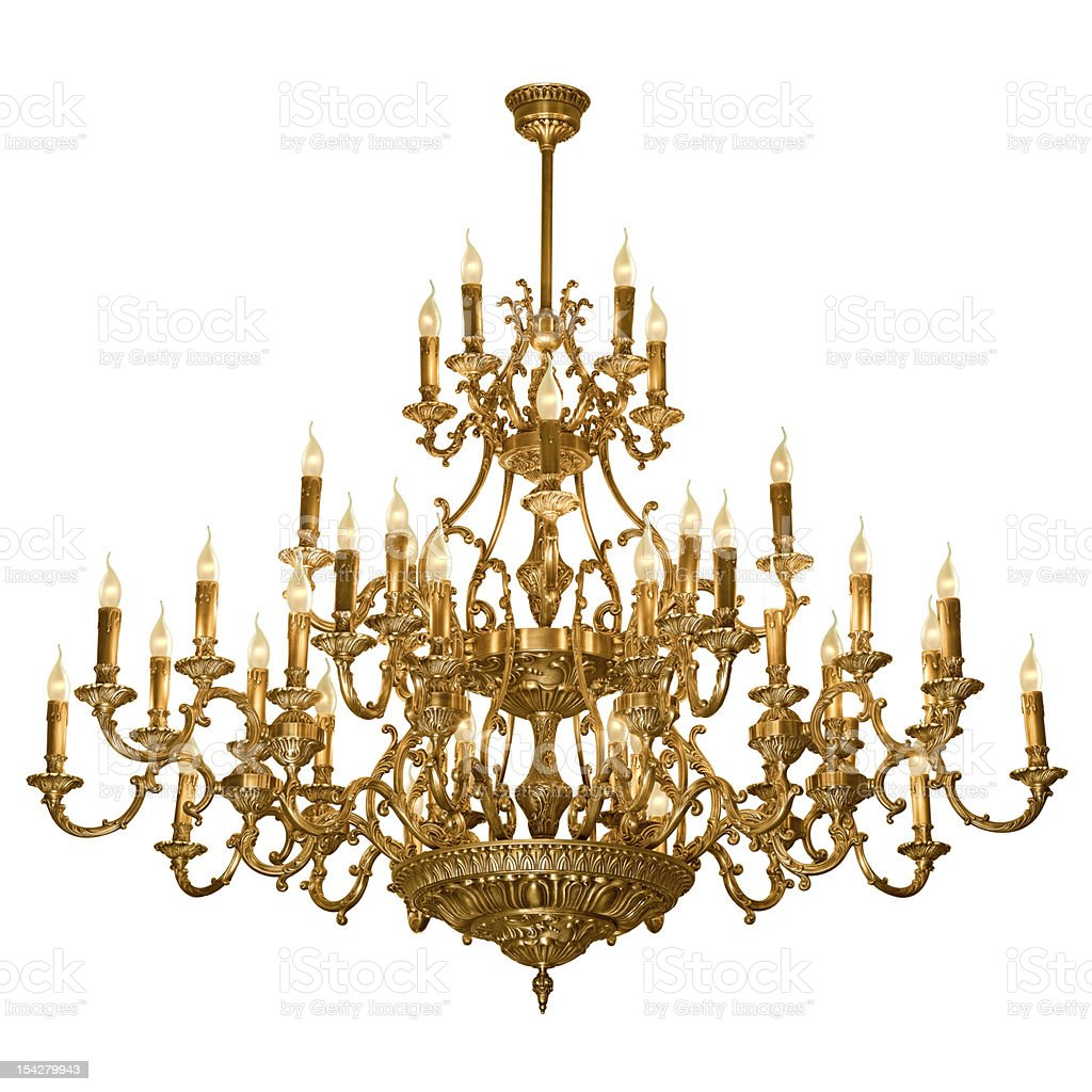 Ornate, tiered, brass chandelier on a white background stock photo