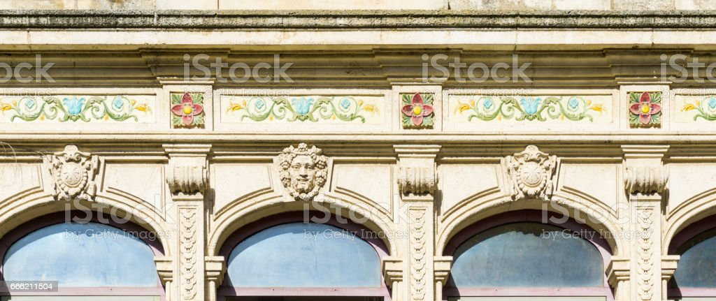 Ornate traditional architectural facade on city building, France. stock photo