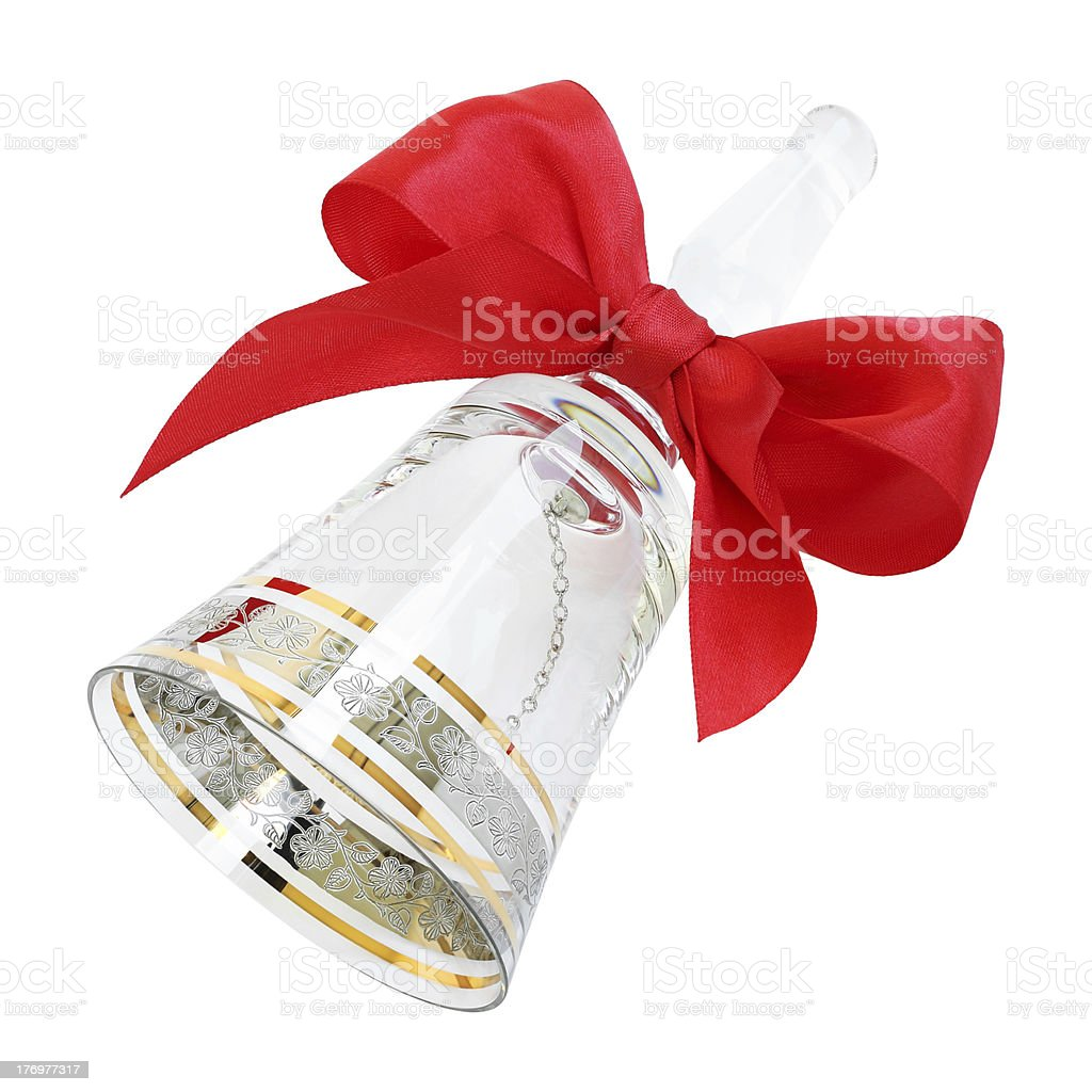 Ornate transparent crystal handbell with a red satin bow stock photo