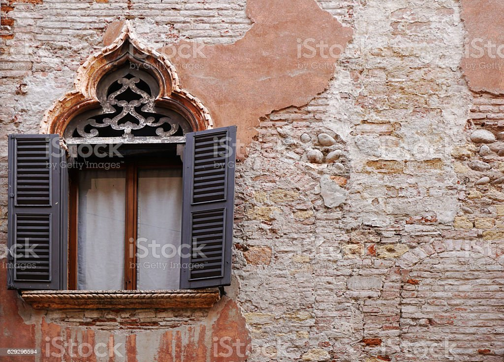 Ornate window and old wall in Verona stock photo
