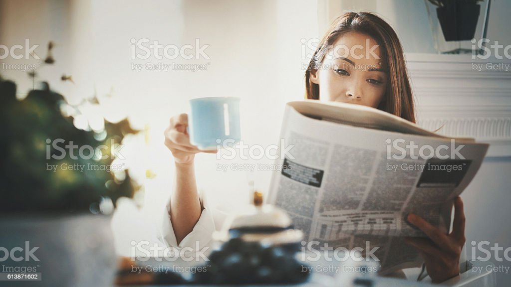 M orning routine with coffee and newspapers. stock photo