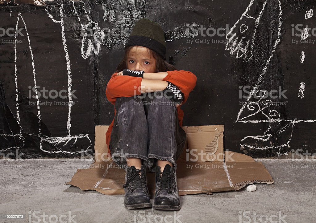 Orphan child on the street concept stock photo