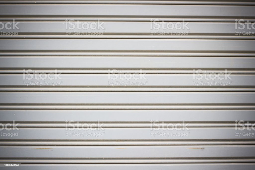 orrugated metal sheet fence with natural grainy texture stock photo