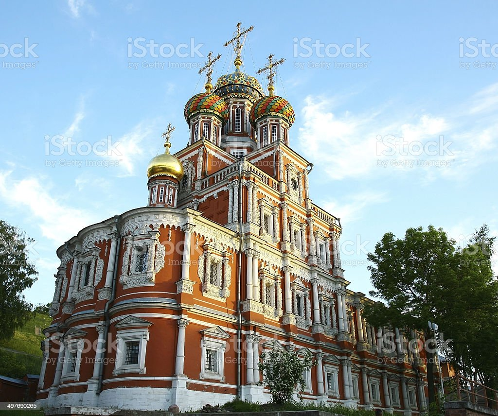 Orthodox christian church with colorful domes at sunset stock photo