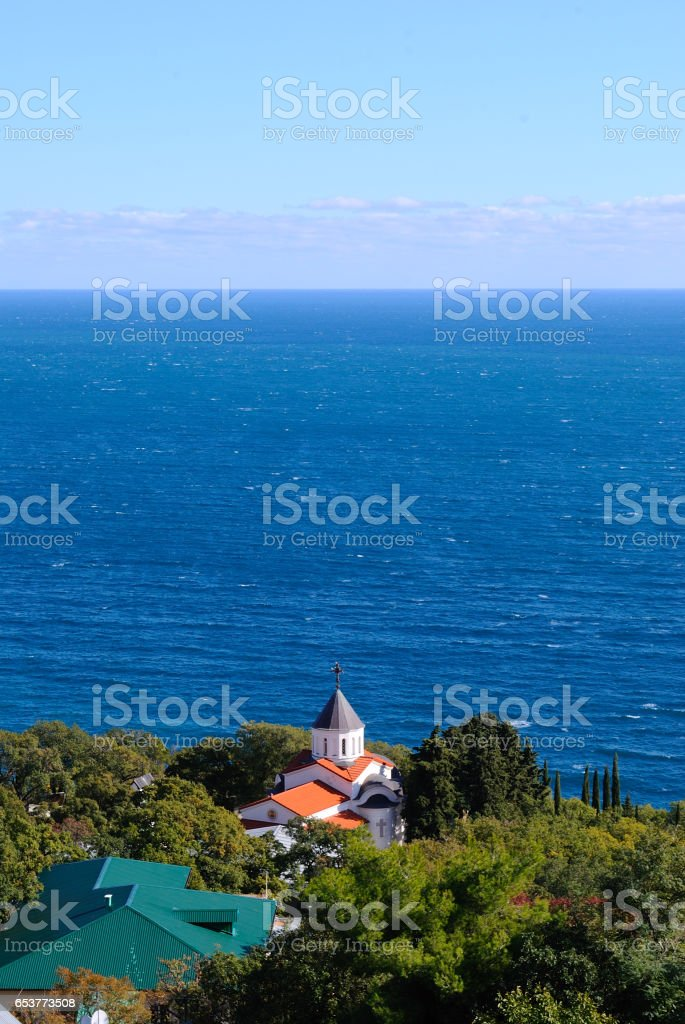 Orthodox church against the sea stock photo