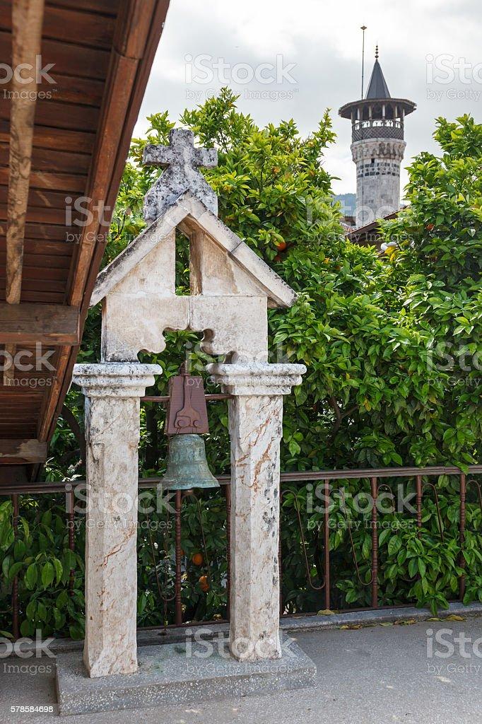 Orthodox Church and mosque  minaret in Hatay (Antakya), Turkey. stock photo