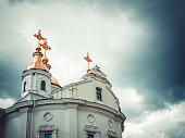 Orthodox Church and the stormy sky. The power of faith