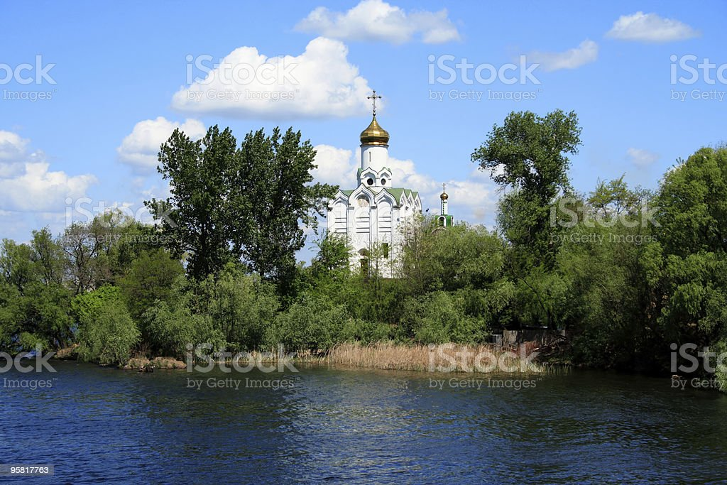 orthodox church on a river bank stock photo