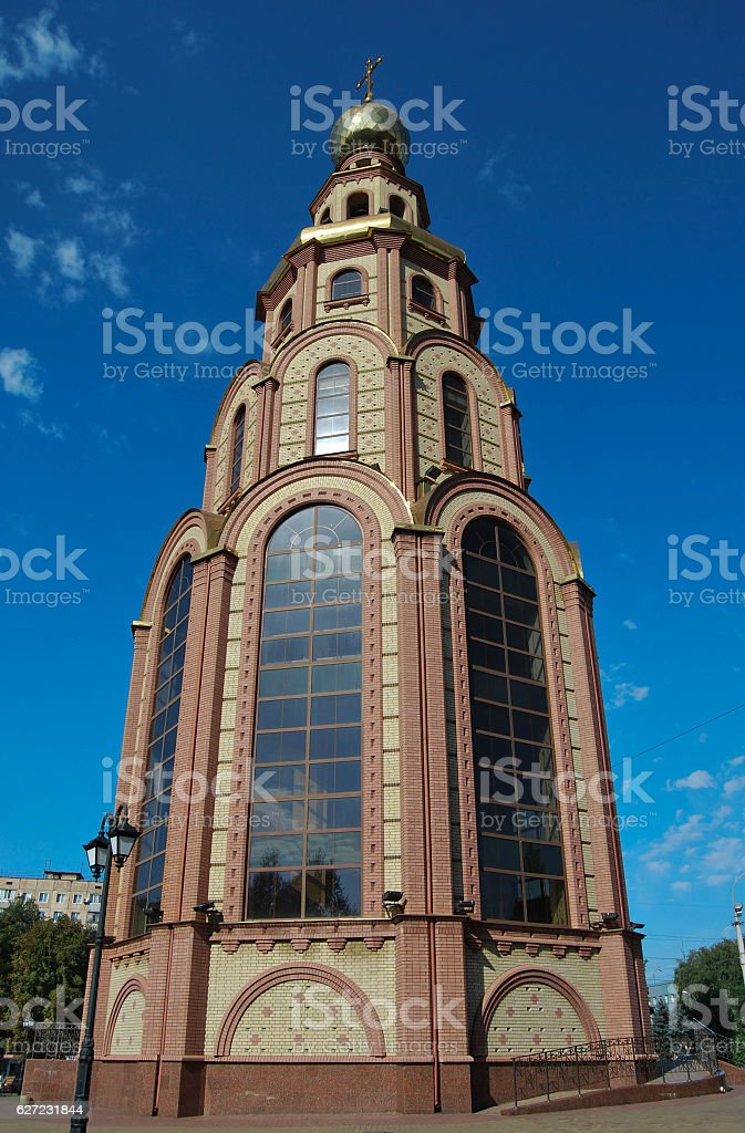 Orthodox church on the background of nature and the blue sky stock photo