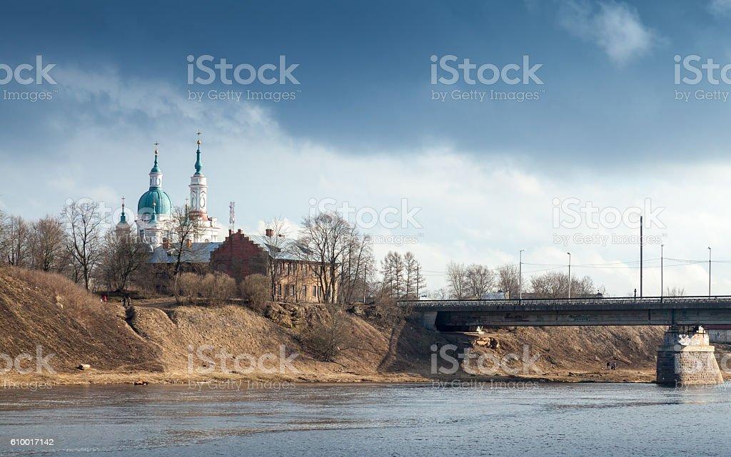 Orthodox church on the river coast. Kingisepp stock photo