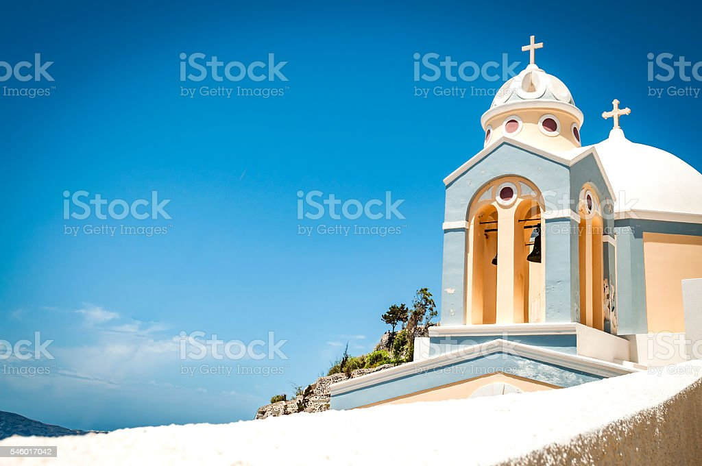 Orthodox Church with clouds on the island of Santorini, Greece stock photo