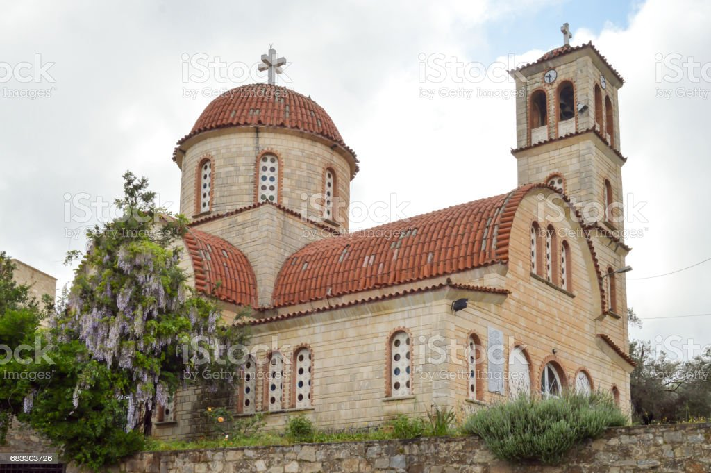Orthodox church with purple lilac stock photo