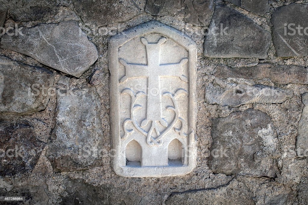 Orthodox cross carved on the wall of the church stock photo