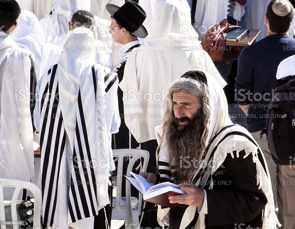 Orthodox Jew praying at western wall stock photo