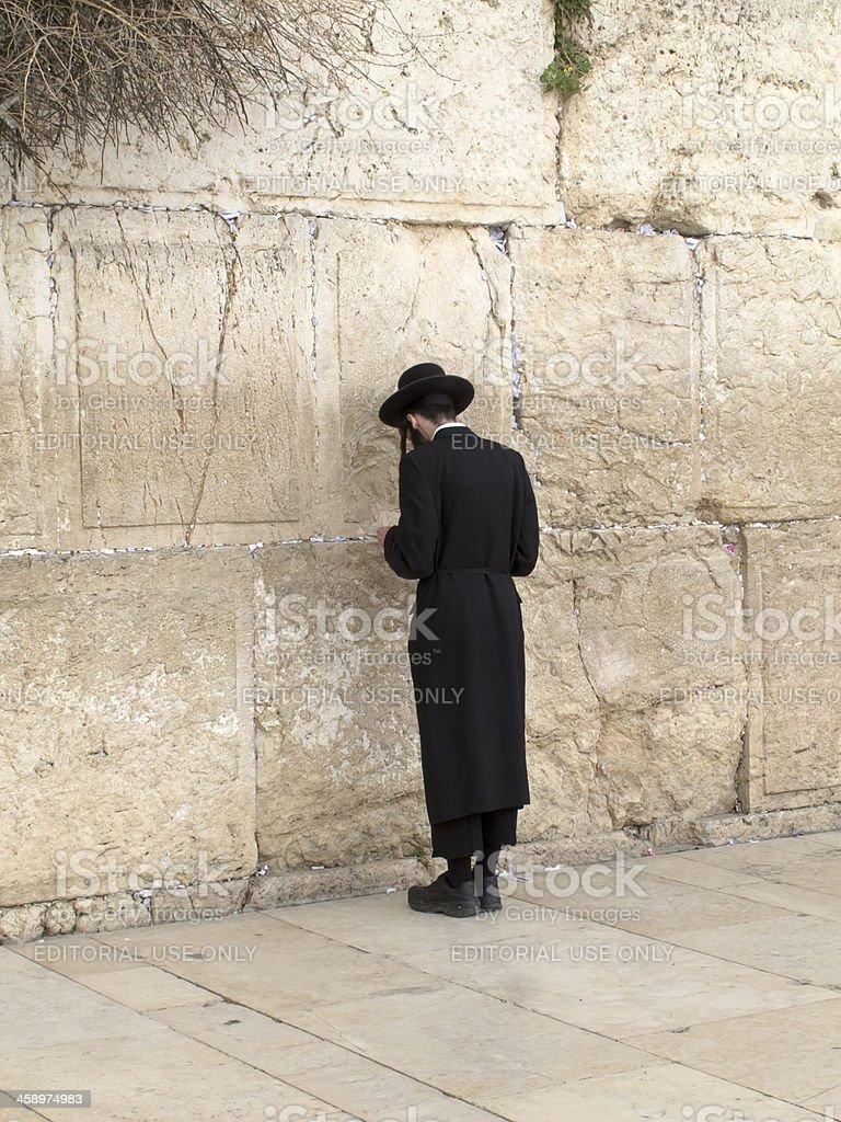 Orthodox Jewish man prays at Western wall royalty-free stock photo