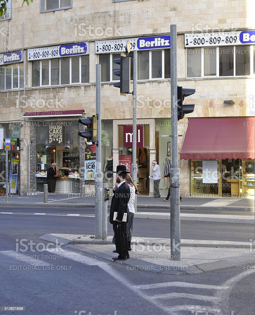 Orthodox Jewish man standing on a street corner Jerusalem, Israel stock photo