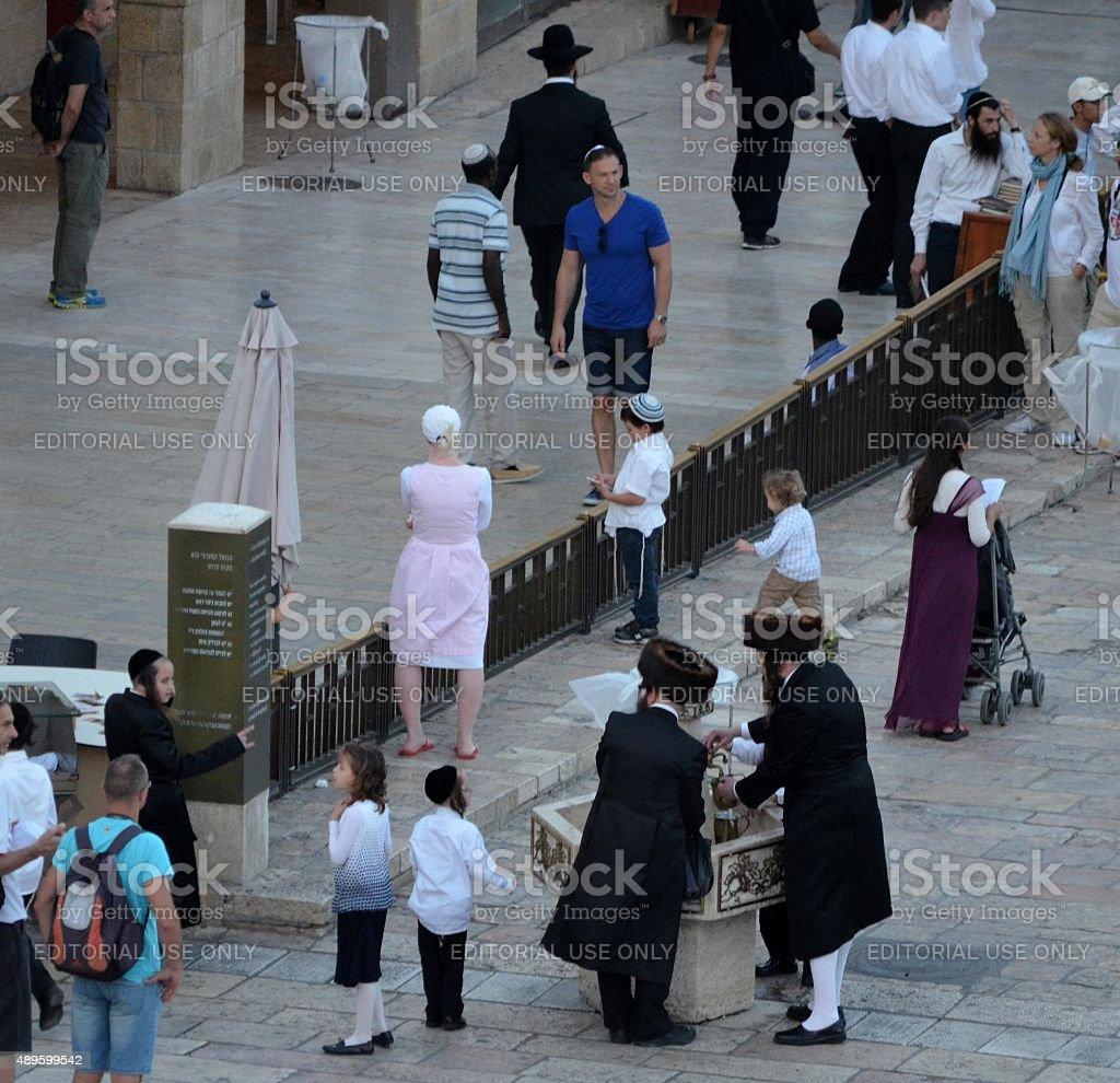 Orthodox Jewish Men Washing their Hands near the Western Wall stock photo