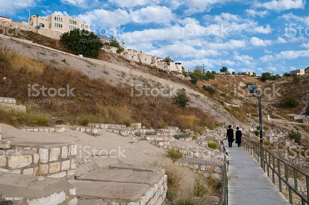 Orthodox Jews in cemetery in Safed, Israel stock photo