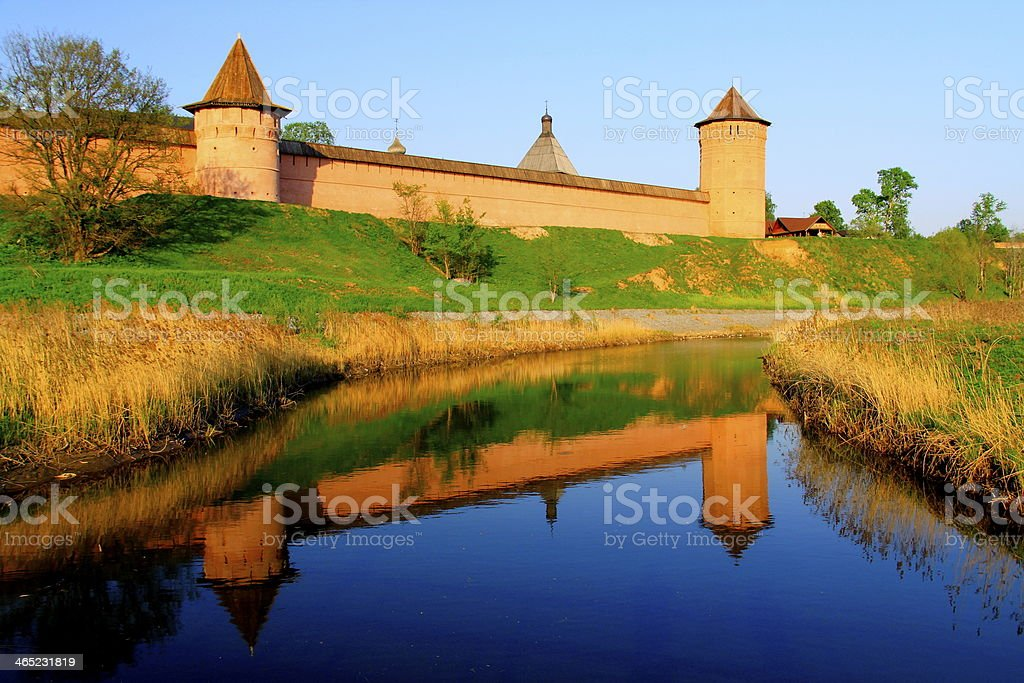 Orthodox Monastery kremlin, river reflection sunset, Suzdal, Russia stock photo