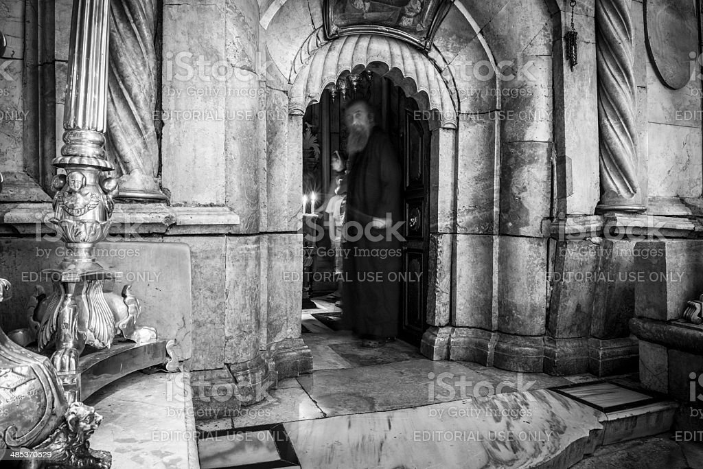 Orthodox monk at entrance to tomb of Jesus stock photo