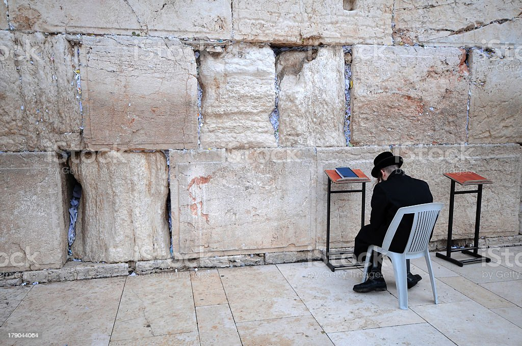orthodox person pray at the western wall stock photo