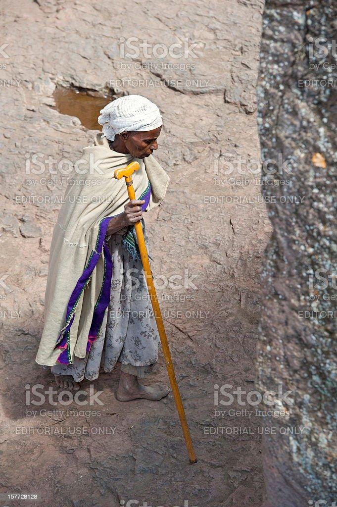 Orthodox pilgrim outside of a rock hewn church, Lalibela, Ethiopia royalty-free stock photo