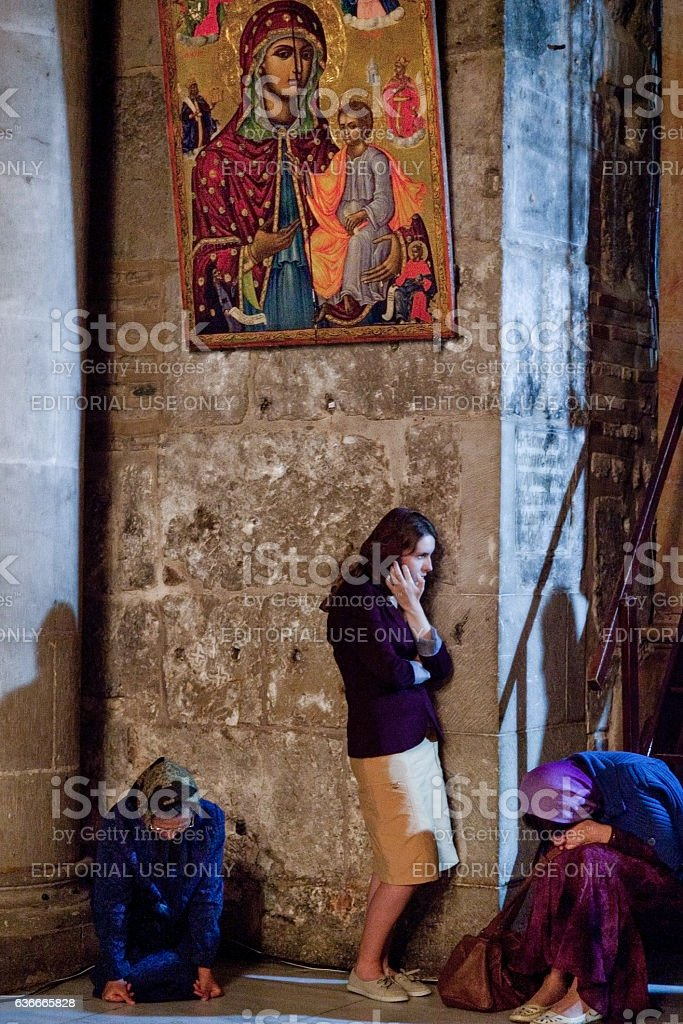 Orthodox pilgrims prays at the icon in Holy Sepulchre Church stock photo