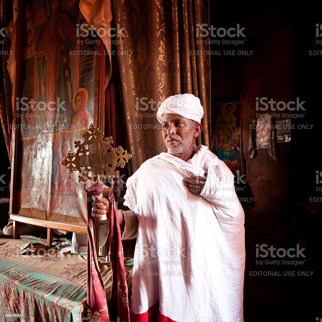Orthodox priest standing inside a rock-hewn church,Lalibela, Ethiopia stock photo