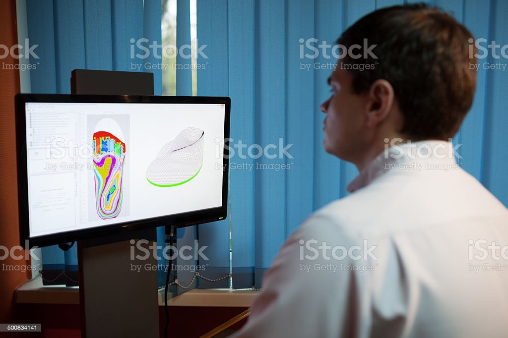 Orthopaedist at work with digital footstep model stock photo