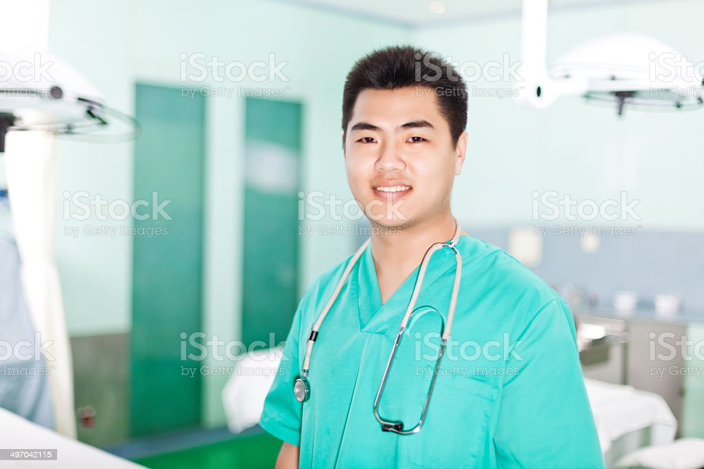 orthopedic surgeon in the operating room stock photo