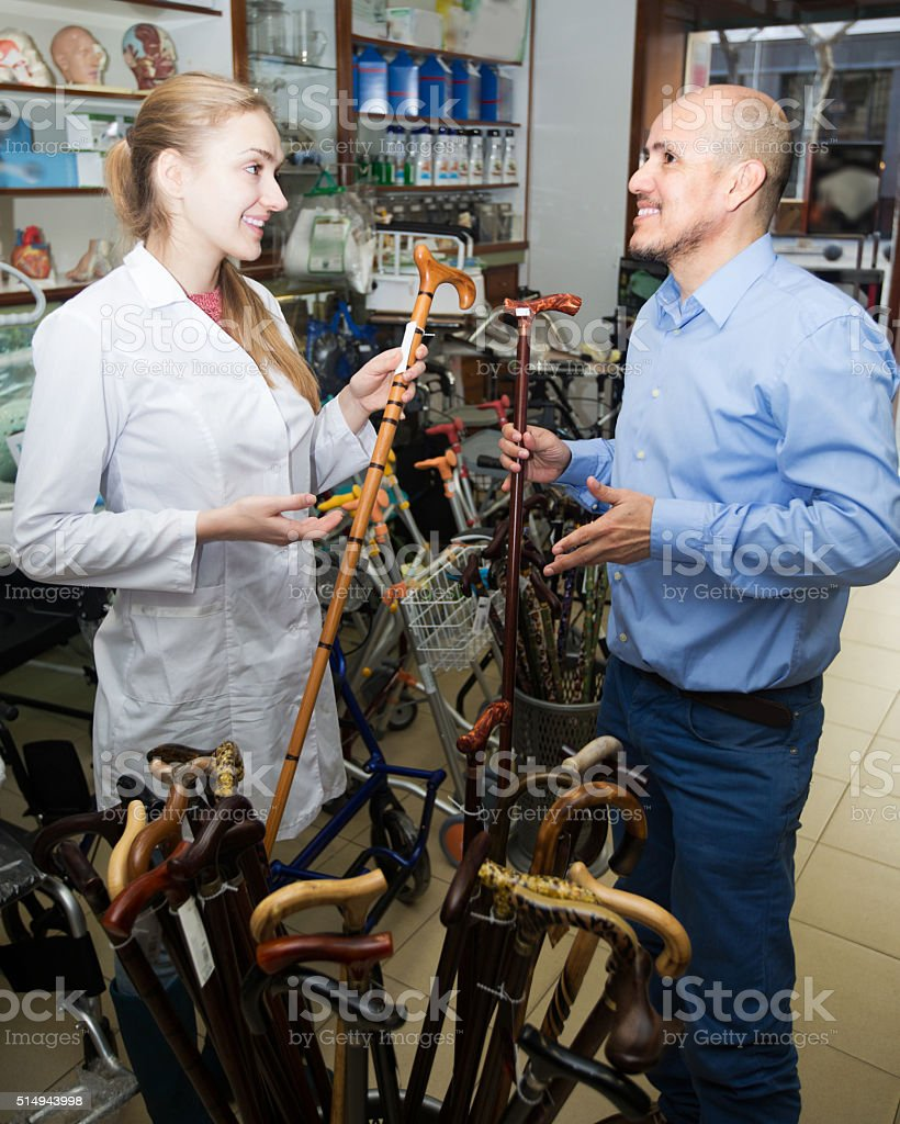 Orthopedist consulting client about sticks stock photo