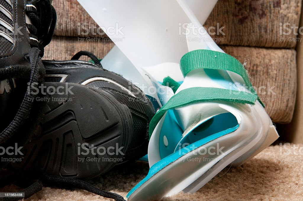 Orthotics on floor with shoe royalty-free stock photo