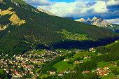 Ortisei Alpine village meadows sunrise, Dolomites, Italian Tirol alps