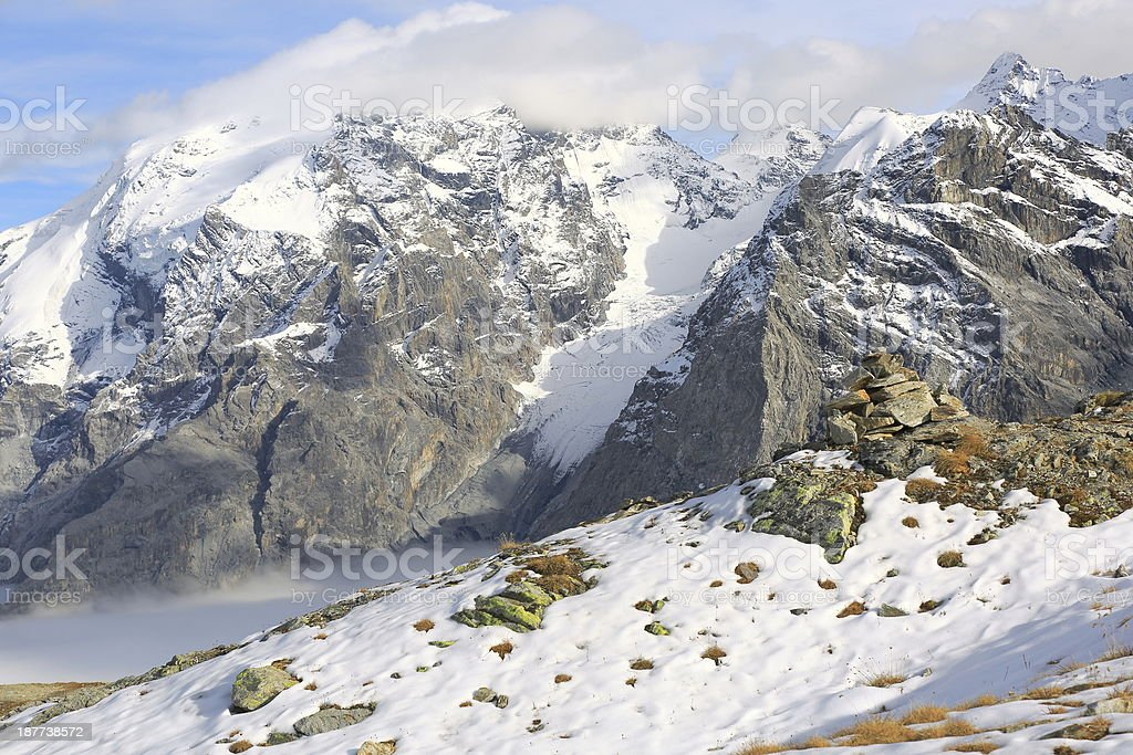 Ortler Mountain range alps above snow and mist, Italy stock photo