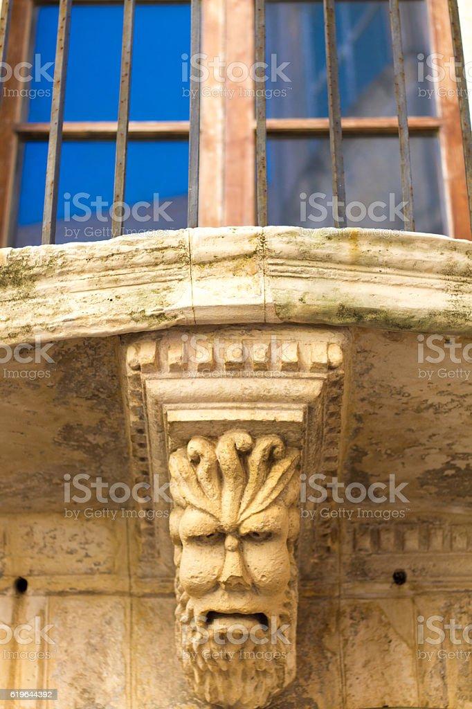 Ortygia, Siracusa, Sicily: Ornate Baroque Balcony with Grotesque stock photo