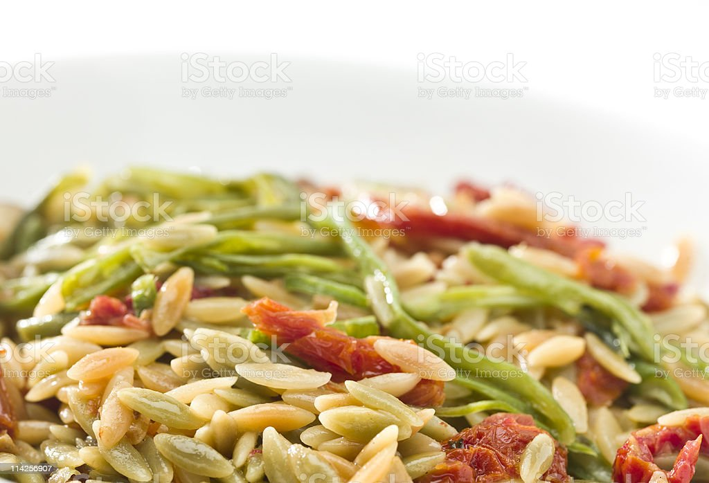 Orzo Pasta with sundried tomatoes royalty-free stock photo