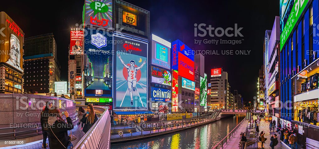 Osaka Glico Man neon signs Dotonbori tourists photographing billboards Japan stock photo