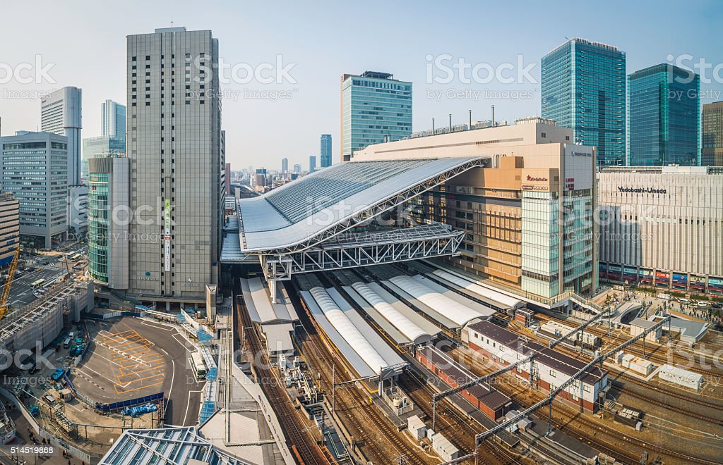 Osaka Station rail tracks platforms and skyscrapers Umeda Japan stock photo