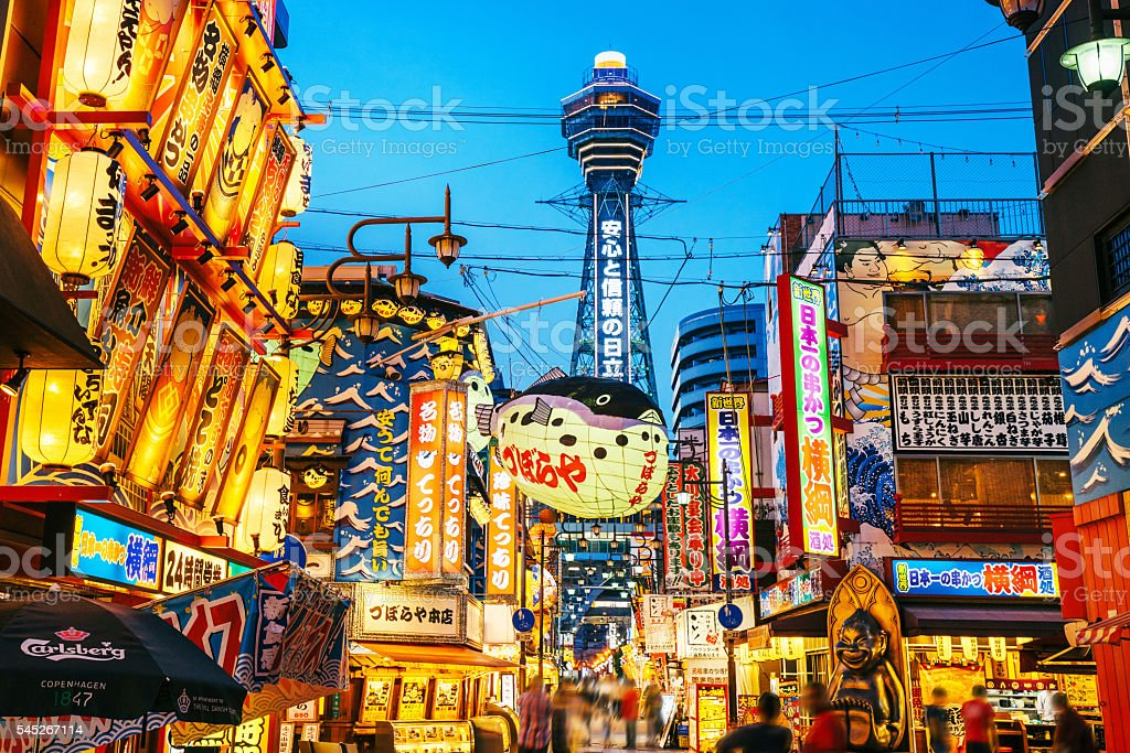 Osaka Tower and view of the neon advertisements Shinsekai district stock photo