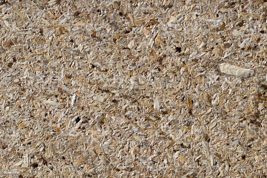 osb - oriented strand board or qsb - quality strand board, chipboard texture or chipboard background  with copy space for text or image. stock photo