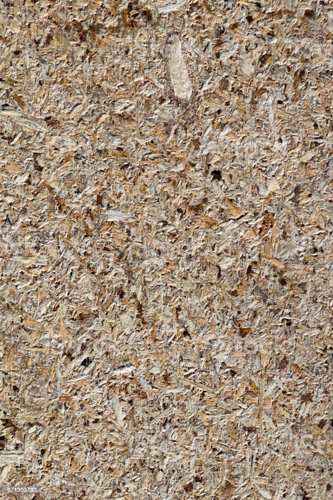 osb - oriented strand board or qsb - quаlity strаnd bоard, chipboard texture or chipboard background  with copy space for text or image. stock photo
