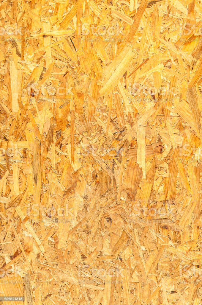 Osb wooden board panel background. Vertical. OSB wood. stock photo