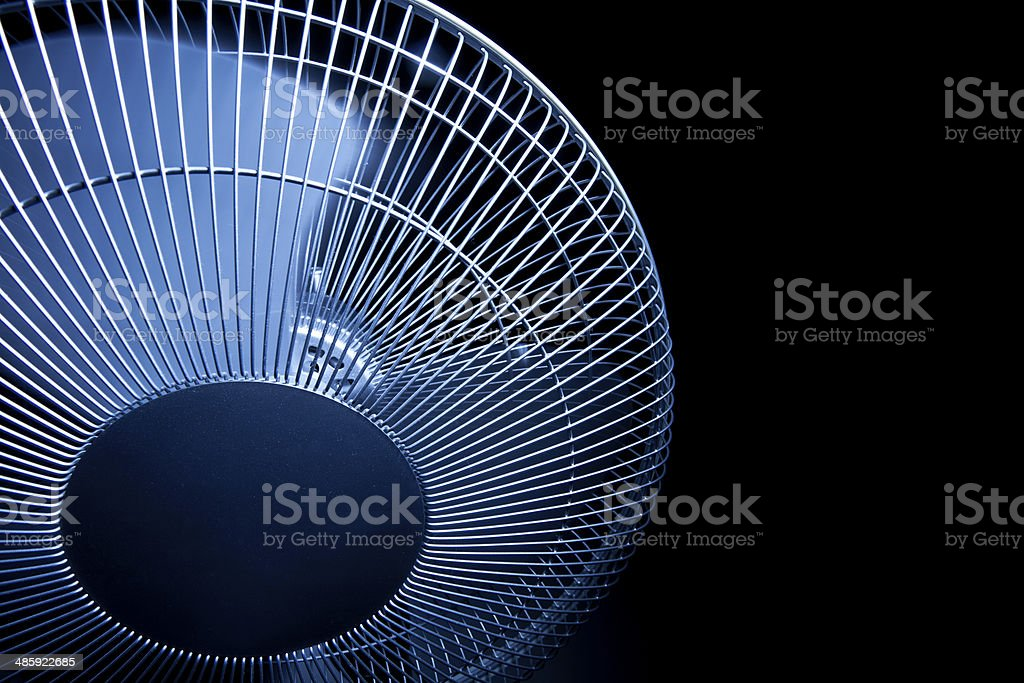 Oscillating office fan on black background stock photo