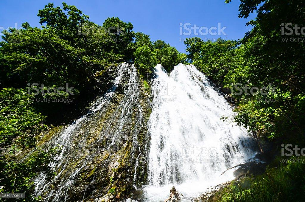 Oshinkoshin Falls in Summer in Shiretoko, Hokkaido, Japan stock photo