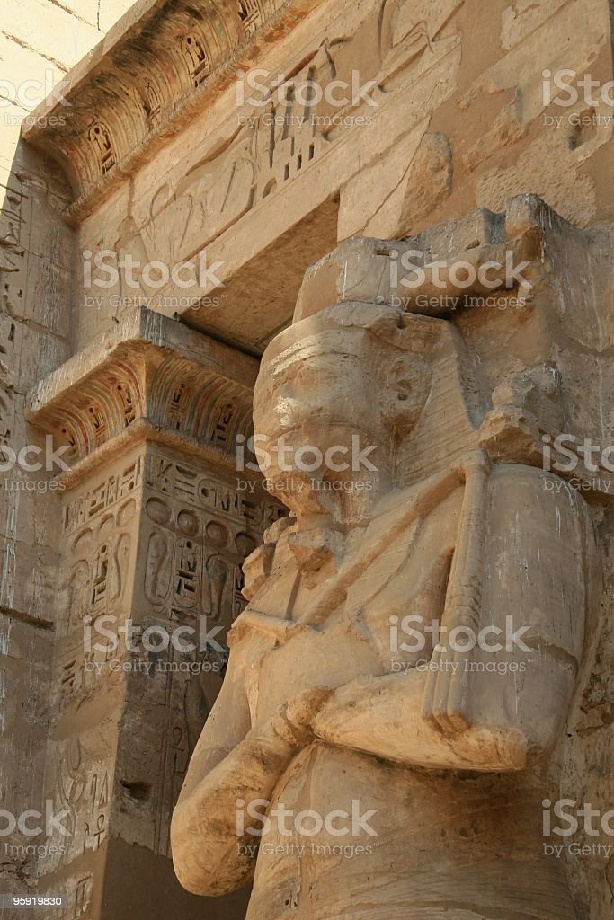 Osiride Statue of the King, Medinet Habu, Thebes, Egypt stock photo