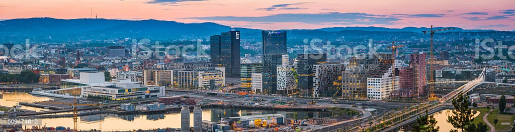 Oslo Barcode Project harbour skyscrapers panorama illuminated at sunset Norway stock photo