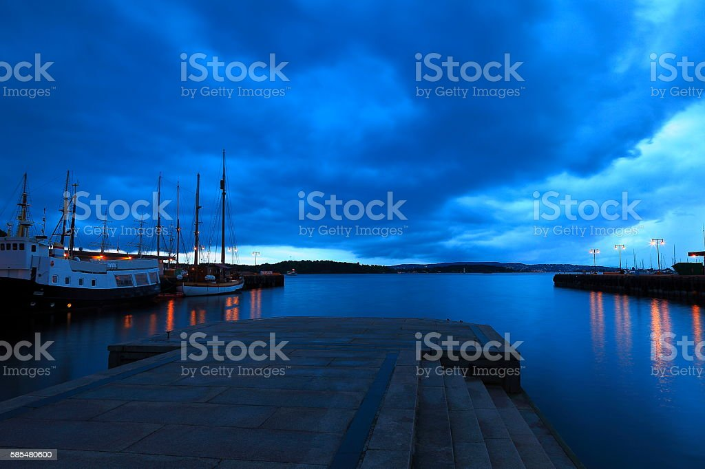 Oslo dock harbor ships panorama, dramatic clouds evening, Norway, Scandinavia stock photo