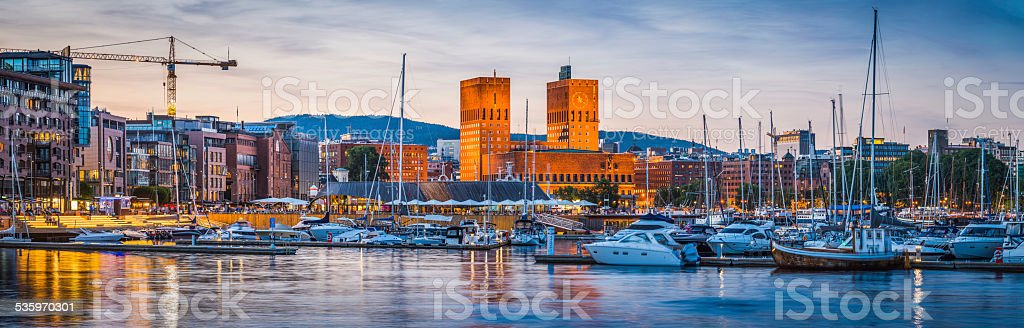 Oslo harbour Aker Brygge City Hall illuminated at dusk Norway stock photo