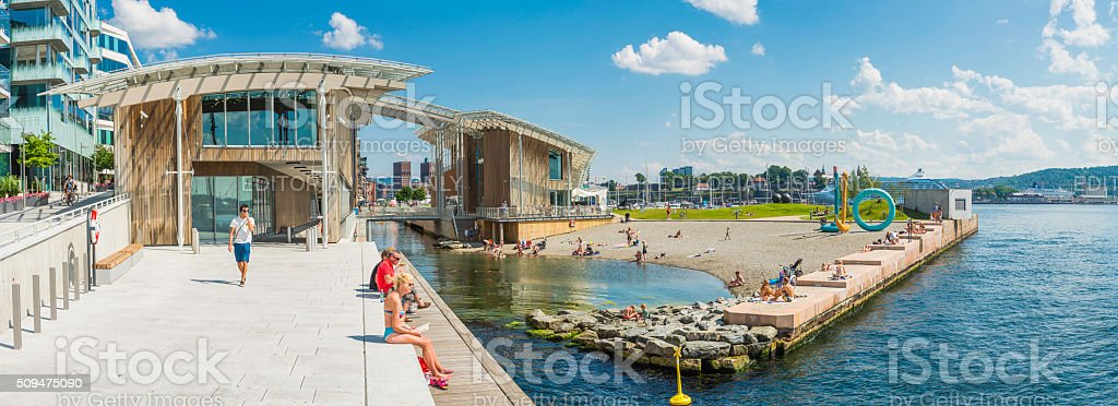 Oslo summer in city people relaxing at Aker Brygge Norway stock photo