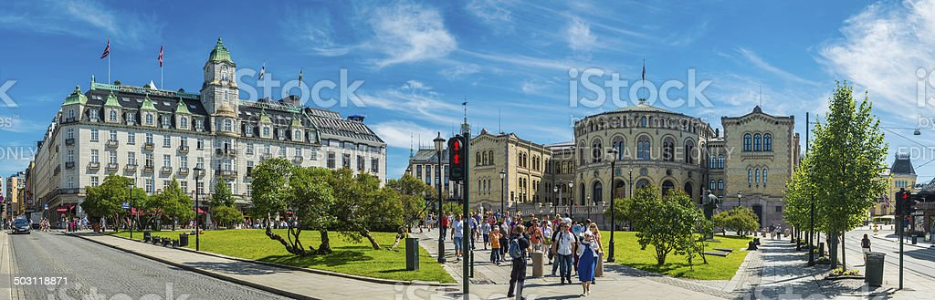 Oslo tourists outside Stortinget Parliament in sunshine Norway stock photo